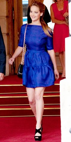 In Paris, Lawrence took in haute couture fashion week in a bright cocktail dress, chainstrap bag and platform sandals.