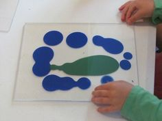 Painting on Plexiglass, then printing with another piece of Plexiglass so that kids can see the entire process. To make a print on paper, sandwich Plexiglass, paper, then Plexiglass.
