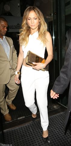 Outfit change: The superstar changed into a white two-piece formed of smart trousers and a...