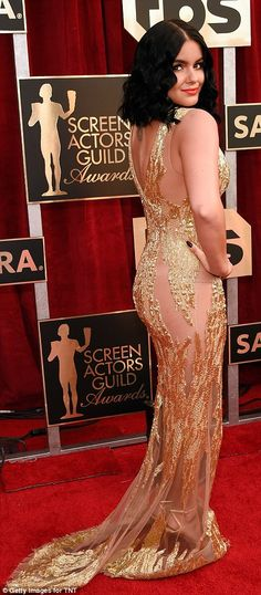 Modern gal! Ariel was a golden goddess in a sequinned gold gown with sheer portions
