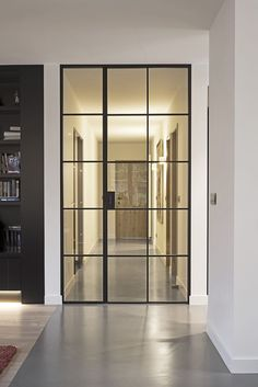 high black lacquered metal door with fixed glass adjacent panel+ Interior Architecture, Interior And Exterior, Interior Design, Exterior Doors, Crittal Doors, Door Design, House Design, Steel Doors And Windows, Inside Doors