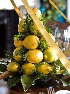 Citrus tree Combine lemons and greenery on a pyramid base to create miniature citrus trees perfect for a dining room centerpiece.