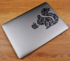 Floral Stylized Squirrel for Apple Macbook and other Laptops ...  Price : 4.90 EURO ( S&H if applicable) ...Why words to describe this? This decal is exactly as seen on the sample image... a beautifully floral stylized squirrel decal for your laptop! Please notice that this decal covers ...
