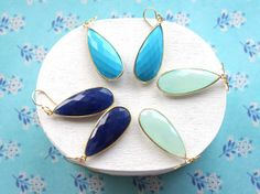 Gorgeous earrings in hues of blue and green by RemyandMeJewelry on Etsy.