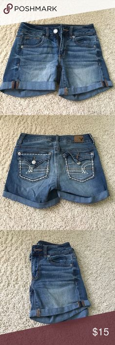 AE Midi Denim Shorts American Eagle denim shorts. Midi in length.  Cute design on back pockets.  Permanent cuffs at bottom.  Washed but never worn.  Feel free to comment for more details. Offers welcome. American Eagle Outfitters Shorts Jean Shorts