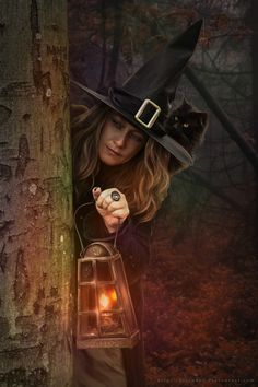Witch with lantern.
