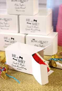 After revealing the gender of your baby, don't forget to send guests home with a slice of your big news. Personalized gender reveal cake slice favor boxes are such a cute souvenir idea for friends and family to take home after your party.  They also make a great decoration idea for the cake table and are an easy way to package leftovers for guests to enjoy later. These boxes can be ordered at http://www.tippytoad.com/personalized-baby-shower-cake-boxes.asp