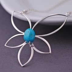 Turquoise Lotus Necklace from georgie designs personalized jewelry
