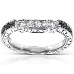 @Overstock - This brilliant prong setting round-cut diamond black wedding band is the traditional choice for your special day. The high-polish, 14-karat white gold contoured style band is plated with rhodium to give it an unparalleled shine and classy finish.http://www.overstock.com/Jewelry-Watches/14k-Gold-1-4ct-TDW-Black-and-White-Diamond-Curved-Wedding-Band-H-I-I1-I2/6611053/product.html?CID=214117 $389.99