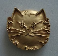"The Cat Friends Club membership pin designed by Jean Cocteau. ""I love cats because I enjoy my home; and little by little, they become its visible soul.""  - Jean Cocteau"
