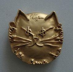 The Cat Friends Club membership pin designed by Jean Cocteau.
