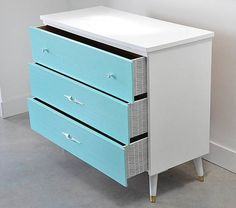 Add pattern to the sides of your dresser drawers with scrapbook paper.
