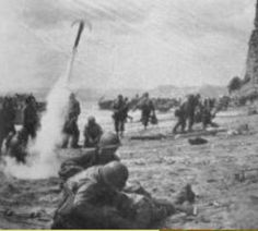 "US Ranger Battalion in pre D-day training exercise with rocket-propelled grapnels, probably at Bude, Cornwall, early Medic attends to pretend ""casualty"" in foreground. Battle Of Normandy, D Day Normandy, Normandy Beach, Normandy Invasion, D Day Landings, Band Of Brothers, Military Veterans, France, Military History"