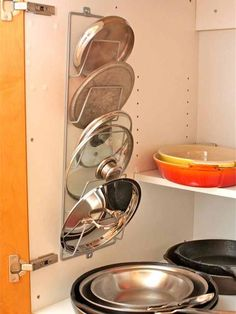 Use a magazine rack to store pots and pans lids. Saves tons of extra space! Another great idea is to use old tension curtain rods to separate cutting boards, etc.