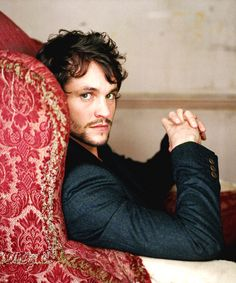 Hugh Dancy- whats with british men posing in red chairs.
