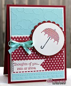 Stampin' Up! Rain or Shine Stamp Set for 2013 Spring Catalog...Pool Party, Cherry Cobbler, Whisper White are the card's colors and Cardstock plus Red Glimmer Paper and background uses the Cloudy Day and Needlepoint Border Embossing Folders...ribbon is from the Sale-A-Bration catalog