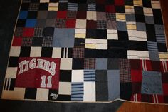 This is a twin size memory quilt that was made for a customer. She had recently lost her brother and wanted a special gift to give to her Mother. She sent me her brother's jeans, khakis, t shirts, jerseys, pants of all kinds, and cotton shirts. This is the quilt that was made for her. She was extremely pleased with how it turned out. This is such a wonderful way to remember your loved ones. This is a quality quilt that will bring years of comfort and peace for years to come.  Send me a…