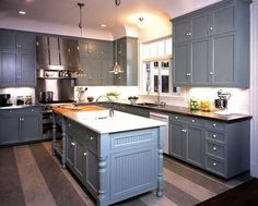 kitchens - gray blue shaker kitchen cabinets black granite countertops blue gray kitchen island butcher block countertop
