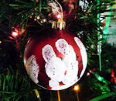 Check Out These Fun and Free Snowman Crafts: Handprint Snowman Ornament