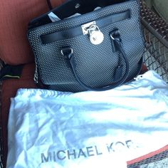 Michael Kors micro studded Hamilton RARE Beauty. Has a slight scratch on the back but is very shallow and nothing close to a tear. Otherwise it looks in excellent to new condition. I think the scratch was when I was moving the bag 😟  purse hasn't been used. Michael Kors Bags Totes