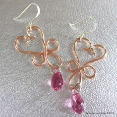 Gorgeous handmade bright solid copper 18 gauge heart coming out of a cross shaped wire wrapped earrings with sparkly pointed Swarovski crystal tear drops and sterling silver fish hook ear wires. Lengt
