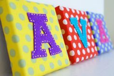 canvas covered with fabric and a felt letter!