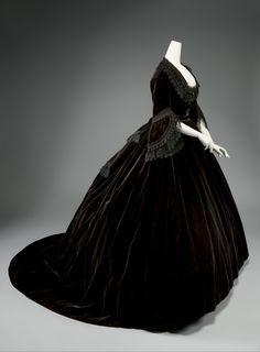 "Dress  Date:     ca. 1861  Culture:     French  Medium:     silk  Credit Line:     Gift of M. C. Edwards, 1990   Marking: [label] ""Alexandrine Goujon, rue St. Honore 233"""