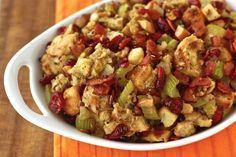Cranberry walnut stuffing 1 cup butter or margarine 3/4 cup chopped onion 9 cups bread crumbs 1/2 cup dried cranberries seasoning to taste 1/2 cup finely chopped walnuts 1/2 cup bacon bits (optional)