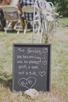 Two families are becoming one, so please pick a seat, not a side. | Photo by http://crystalmariesing.ca Floral design by http://comoxvalleyflowermart.ca
