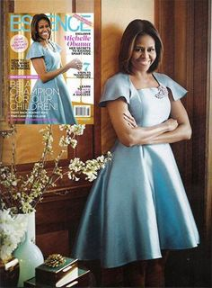 The FLOTUS covers the August 2014 issue of ESSENCE Magazine wearing a dress by designer Azede Jean-Pierre.