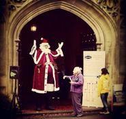 Christmas themed stilt walkers for hire. Santa themed stilt walker for hire in London and the UK.