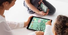 Children playing games on a tablet.