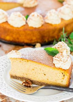 Pumpkin Ricotta Cheesecake - a not so classic creamy cheesecake infused with pumpkin puree and ricotta cheese over a walnut crust, served with a dollop of pumpkin whipped cream.
