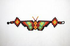 Butterfly Bracelet Huichol Beadwork Native by BiuluArtisanBoutique Butterfly Bracelet, Butterfly Jewelry, Beaded Braclets, Unusual Flowers, Mexican Designs, Beaded Animals, Peyote Patterns, Animal Jewelry, Bead Art