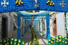 The Festa dos Tabuleiros, or the Festival of the Trays, takes place every four years in Tomar, Portugal, during the summer. Originating in the 1200s, the festival takes its name from the towering tabuleiros decorated with 30 loaves of bread and colorful paper flowers that are balanced on the heads of more than 400 women during the weeklong festival's final procession. The festivities kick off with a street-decorating competition, during which townspeople decorate the streets of the city with…