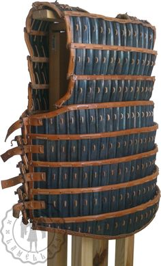 Byzantine lamellar armor. Reconstruction of lamellar plates on the basis of a finding from the Great Palace of Constantinople- dated 2nd half of 12th century (probably the last quarter). Lamellar plates reforged by hand and blackened in the hearth. Fluting on each plate was also incused by hand. Lining made of vegetable tanned cattle leather, the strap as well (cut by hand). The holes in the lining burned. Wrought-iron buckles. The whole item preserved with linseed oil. www.lykia.pl