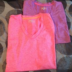 Xersion Vneck Top Bundle Two for one!  This special includes: 1 Short Sleeve M Purple Xersion Top and 1 Short Sleeve M Pink Xersion top  Xersion Tops Tees - Short Sleeve