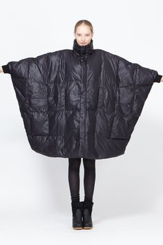 Quilted down coat with a wide cut and dolman sleeves, funnel neck, front zip and snap button closure, vertical slip pockets over chest. Consider airing rather than washing.