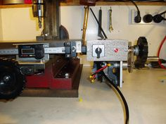Bi-directional power drive for small milling machine