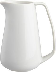 pure pour.  Simple statuesque form pours 8 ounces of creamer or syrup in white stoneware.  Matte exterior contrasts slick interior. HandmadeDipped stonewareMatte white exterior; glazed white interiorDishwasher-safeMade in China.