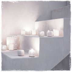 white candles <3  make skinny steps going up a wall and add candles