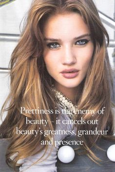 Rosie Huntington-Whiteley {pretentious guff strap-line beneath her.}