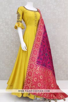 Palkhi fashion exclusive light yellow pure silk indian outfit with bell sleeve look.pure banarasi silk pink dupatta with this elegant anarkali suit. Indian Dresses Online, Indian Gowns Dresses, Pakistani Dresses, Gowns Online, Indian Wedding Dresses, Designer Anarkali Dresses, Designer Dresses, Indian Designer Outfits, Indian Outfits
