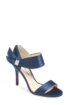 Free shipping and returns on Nina 'Cosmos' Sandal (Women) at Nordstrom.com. A crystal-encrusted brooch highlights the pleated ankle strap of a graceful satin sandal that provides the perfect finishing touch for your evening ensemble.