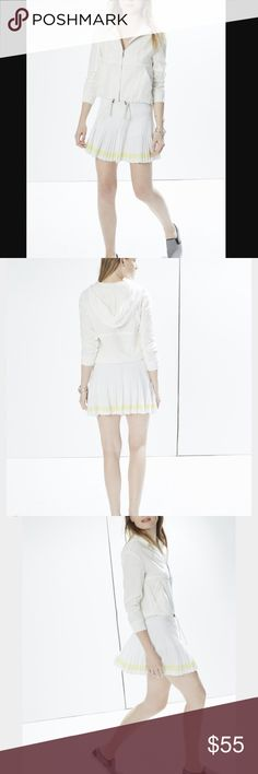 Rebecca Minkoff Crissy Skort Fun white sweater skort from Rebecca Minkoff! White pleated sweater material with a neon yellow stripe along the bottom. Shorts underneath! Elastic pull on waist! NWT from Nordstrom Rack, original brand tag not attached. Rebecca Minkoff Skirts