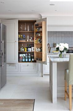 Large pantry storage doors, drawers beneath