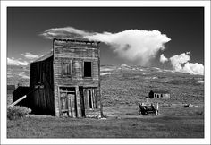 Remains of the Swazey Hotel near the corner of Main and Green Streets in Bodie California.    Bodie is a California State Park as well as California's Official Ghost Town and is located between the towns of Bridgeport and Lee Vining off US 395. While 95% of the town's buildings have succumbed to fires and neglect the remaining structures (~200) are preserved in a state of arrested decay.