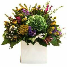 "Preserved floral arrangement in a ceramic planter.Product: Preserved arrangement    Construction Material: Preserved florals and ceramic    Color: MultiFeatures: Includes preserved floral arrangement     Dimensions: 14"" H x 14"" W x 14"" D"