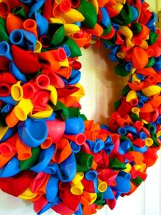 I first saw a balloon wreath on my neighbor's door. It was love at first sight. Needless to say, this will be my next wreath project. Cannot wait. Aaron's birthday is in May, so time's ticking!