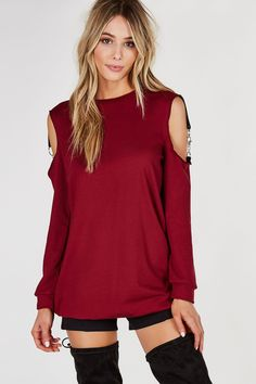 Crew neck pullover tunic with long sleeves and cold shoulder finish. Hook clasp detailing with cut out in back for added detail. - Cotton-Polyester blend - Made in USA - Model is wearing size S - Runs